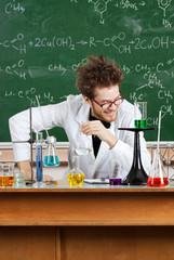 Mad professor laughs in his laboratory