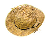 An old ragged straw hat on a white background