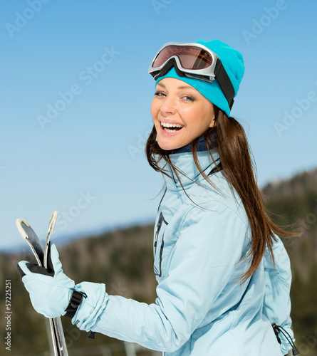 Half-length portrait of woman downhill skier