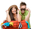 Couple packs up suitcase with clothing for trip