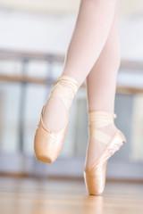 Close-up of dancing legs of ballerina