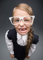 Wide angle portrait of little girl in glasses