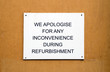 Refurbishment sign on wooden background