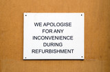 Refurbishment sign on wooden background poster