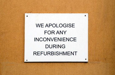 Refurbishment sign on wooden background