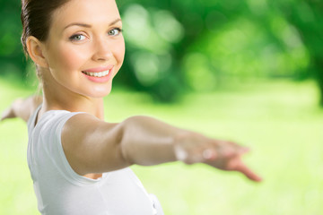 Portrait of girl with outstretched arms exercising