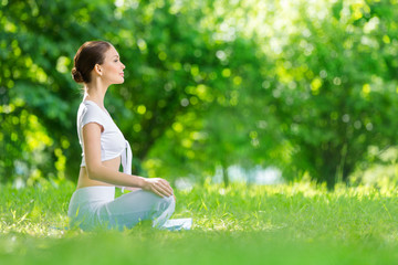 Profile of woman who sits in asana position