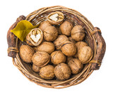 a basket with walnuts on a white background