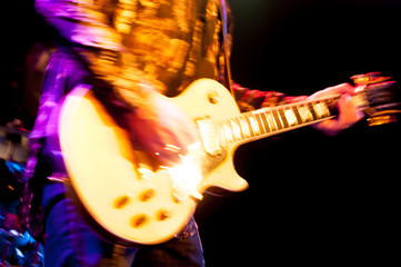 motion blur glam rock guitarist