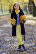 Autumn fun - lovely girl has a fun in autumn park