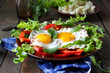 fried eggs with herbs and paprika for breakfast