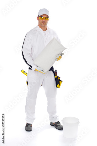 worker in white overalls holding a bucket trowel tools package