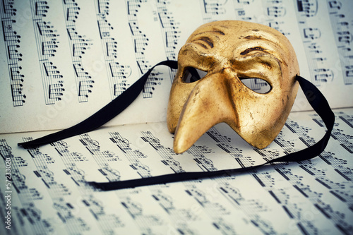 Venice mask on musical score