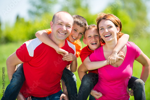 Happy family with two children on nature