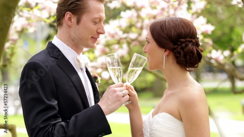 Bride and groom enjoying champagne on their wedding celebration