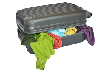 Suitcase with pile of colorful shirts