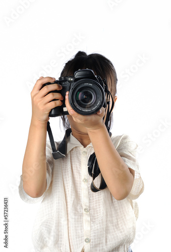 Portrait of asian little girl holding photo camera isolated
