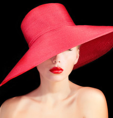 beautiful mysterious woman with red lips and in hat