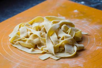 Crude homemade Italian pasta tagliatelli, freshly prepared