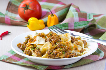 Italian pasta tagliatelle with meat sauce and vegetables, tasty