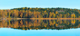 Autumn colors at a lake with reflections - Panorama