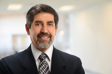 Hispanic Businessman Smiling