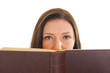 Attractive young girl reading book