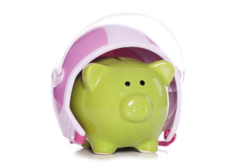 piggy bank wearing a crash helmet