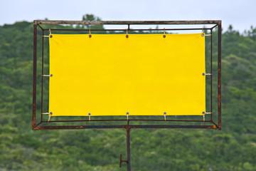 Yellow rusty sign