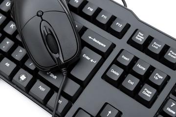 black mouse over black keyboard