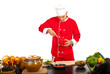 Chef male cutting pepper