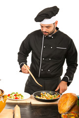 Chef garnish vegeatbels on plate