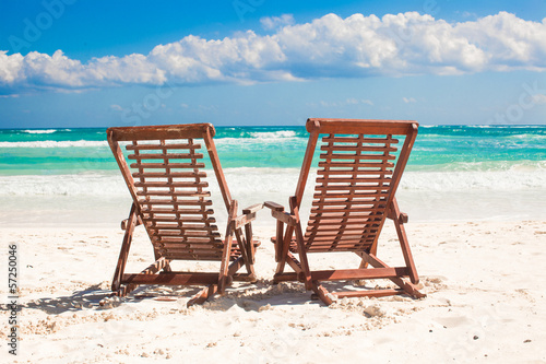 Beach wooden chairs for vacations and relax on tropical white © travnikovstudio