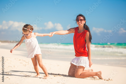 Mother with her cute daughter enjoy the holiday and having fun