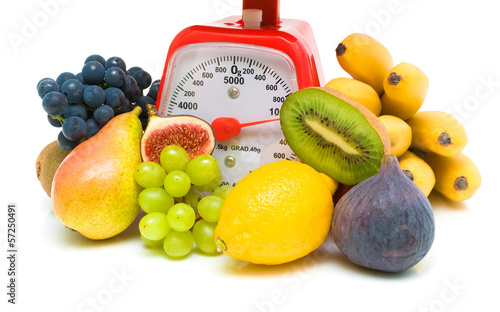 fresh juicy fruits and red scales. white background.