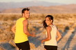 Exercise - couple running looking happy