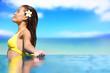 Relaxing serene woman at travel spa resort pool