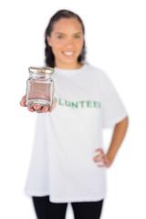 Smiling volunteer woman showing jar