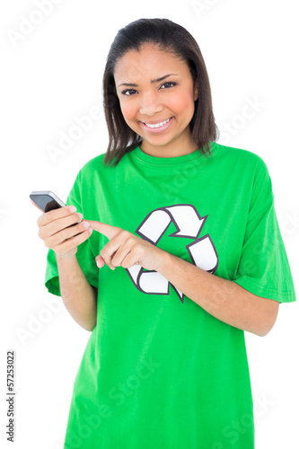 Joyful dark haired environmental activist using a mobile phone