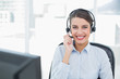 Beautiful classy brown haired operator answering a call