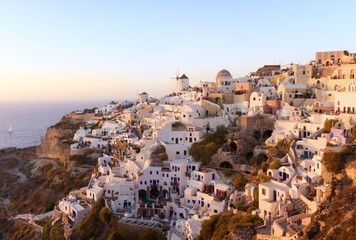Sunset view of Oia village on Santorini island, Greece.