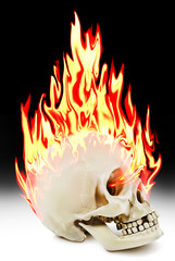 The human skull burning in the fire.