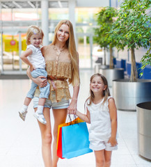 Happy family on shopping in the store