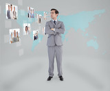 Businessman standing looking at digital interface