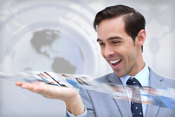 Happy businessman looking at a picture stream