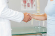Close up of doctor shaking hands with patient