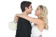 Cheerful pretty bride hugging her husband