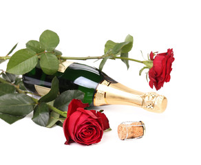 Red rose and a bottle of champagne.