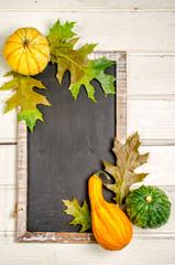 Blackboard with pumpkin. Copy space