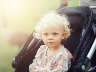 toddler in buggy
